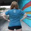 This is the back view of the Strong Athletic Mom Crew Neck T-shirt in Heather Teal with White Ink. This comfy t-shirt is perfect for working out in because the fabric moves with your body. The material on this traditional tee goes down to the mid thigh and is super soft. We made this shirt because we're inspired by all of the strong moms in the world who are showing their children that women and moms belong in sports and athletics.