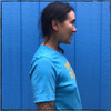 This is the side view of the Strong Athletic Mom Crew Neck T-shirt in Aqua Blue with Yellow Ink. The sleeves for this t-shirt are not capped, they come down to the mid-arm. Many people like to roll up the sleeves, or they layer this t-shirt on top of their favorite long sleeve in winter. We made this shirt because we're so inspired by all of the strong moms who exercise and take care of their health and their brains. We know how important being physically active can be for mental health and we also know the amazing benefits that come from being on a team. Every time we meet a mom who is passionate about playing sports and being active, we're so inspired.