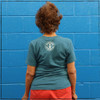 This is the back of the Strong Athletic Grandma T-shirt in Heather Teal with White ink printed on Bella Canvas T-shirt. The Strong Athletic logo is in bold ink on the center of the t-shirt. #Strongathleticgrandma , #strongathleticgrandmother , #strongathleticmom , #grandma #stronggrandma, #stronglikegrandma , #strongathleticwoman , #ilovemygrandma , #strongathletic , #womanownedocompany , #womeninsports