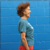 This is the side view of the Strong Athletic Grandma Crew Neck T-shirt by Strong Athletic. This heather teal t-shirt is super soft and comfy.