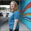 This is the side-front of the Strong Athletic Grandma All-Gender T-shirt in Heather Teal with White Ink. #Strongathleticgrandma , #strongathleticgrandmother , #strongathleticmom , #grandma #stronggrandma, #stronglikegrandma , #strongathleticwoman , #ilovemygrandma , #strongathletic , #womanownedocompany , #womeninsports