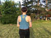 This is the back of the Strong Athletic Woman Deep Heather Teal with Yellow Ink Crop Racerback Tank Top by Strong Athletic. The Strong Athletic logo is printed in bold yellow ink between the shoulder blades. This Bella Canvas tank is one of our favorites.