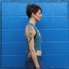 This is the side of the Strong Athletic Queer Deep Heather Teal with Yellow Ink Crop Racerback Tank Top by Strong Athletic. The arm holes are a bit deeper, you can see Rasta's black bra in the photo. #strongathletic #strongathleticqueer , #queerathlete , #lgbtqia2s , #lgbt , #gayathlete , #queersinsport