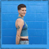 This is the side of the Strong Athletic Queer Deep Heather Teal with Yellow Ink Crop Racerback Tank Top by Strong Athletic. The athlete in this photos has an average length toro. #strongathletic #strongathleticqueer , #queerathlete , #lgbtqia2s , #lgbt , #gayathlete , #queersinsport
