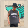 This is the Strong Athletic Trans Muscle Tank that Strong Athletic created for the strong trans athletes in the world who want to play sports, be healthy, stay active and live their best lives. All of the profits from this design are donated to Pull for Pride's Share the Platform Grant.