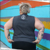 This is the Strong Athletic Queer Crew Neck Gray Muscle Tank with White Ink. This tank is designed by Bella Canvas and is super soft and comfortable. The fabric of this muscle tank is dark grey and the Strong Athletic logo is printed in bright white ink on the back of the tank.