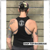 "This is the back of the Strong Athletic Queer Black Racer back Tank by Strong Athletic. The Strong Athletic logo is printed in in white ink on the back of the tank. This crop is considered a ""starter"" crop and doesn't show off as much skin as some crops. The larger this crop is, the longer it goes. This athlete in this photo is wearing a Medium. This black crop tank top was created by Bella Canvas, the style number is 6682. This shirt is preshrunk."