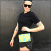 """Take the Yellow with Teal Ink Strong Athletic Bum Bag on your next walk, run or bike ride. It's nice to have a bag that is as durable, tough and up for the challenge as you are. This bag measures approximately 9"""" x 5.5"""" x 0.5"""". It's small enough to carry in your hand as a clutch or to put inside a larger purse, but large enough to carry a wallet, a cell phone, a set of keys, a face mask, a Kindle book reader."""