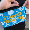 This is the Strong Athletic Woman Light Blue Fanny Pack with Yellow Ink made for Strong Athletic by Flat Track Revolution. This bag is a little bit bigger than the Kindle e-reader, which makes it perfect for people who don't have big pockets, but that don't want to be weighed down by a large bag. To date, we've fit a wallet, cell phone, keys, face mask, lip balm, e-reader and portable reusable grocery bag in ours.