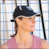 This is a side view of the Strong Athletic Super Light Weight Runner's Hat. The mesh on the hat helps with air circulation during your run. Devon, the athlete in this photo, wears hers to go rowing. This runner's hat is adjustable with a velcro strap. The reflective band makes it easier to see in the dark when light shines on it. The breathable material is also machine washable. This hat can be folded into a smaller size and will bounce right back to it's original shape.