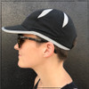 This is the side view of the Strong Athletic Super Light Weight Runner's Hat. The hat is adjustable and can fit a variety of head sizes. Carla, the athlete in this photo, wears hers to go running. This hat can be stuffed into your gym bag and it'll pop right back to it's original shape when you pull it out.