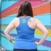 """This is the back of the Strong Athletic Skater Blue Racerback Tank Top with Yellow Ink. The armholes are about average in regard to other tank tops, but the fabric does cut in on the back of the tank, creating that """"racerback"""" design that the shirt is named after. The Strong Athletic logo is printed in yellow ink on the back of the tank. #strongathleticskater , #strongathletic , #strongathleticskaters , #rollerderby , #rampskater , #bowlskater"""
