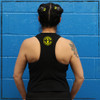 "This is the back of the Strong Athletic Skater Black Racerback Crop Top with Yellow Ink. The material on the back cuts in a bit more so than the average tank top, giving the shirt the ""racerback"" look that it is named for. On the back of the tank the material cuts a slight bit higher than the average tank, giving it that cropped look. The Strong Athletic logo is printed in yellow ink on the back of the tank. #strongathletic , #strongathleticskater , #strongathleticskaters , #rollerderby"