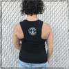 This is the back of the Strong Athletic Skater Black District Muscle Tank with White Ink. The material on the back cuts in a bit more than the Bella Canvas Muscle tanks, revealing more of the shoulders. You can see the athlete's bra in this photo. The Strong Athletic logo is printed in white ink in the center of the back. #strongathletic , #strongathleticskater , #strongathleticskaters , #rollerderby