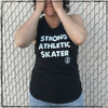 """This is the front of the Strong Athletic Skater Black District Muscle Tank with White Ink. The material for this tank is a bit """"thicker"""" than the material from the Bella tanks, which some people prefer. The arm holes for this tank are cut larger than the average tank, giving it that """"muscle"""" tank look that the tank is named after. We print this design on District Women's Fitted VIT Tank, Style # DT6301. This shirt comes in sizes XS-4XL.#strongathletic , #strongathleticskater , #strongathleticskaters , #rollerderby"""