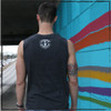 This is the back of the Strong Athletic Skater Heather Grey All-Gender Muscle Tank with White Ink. The Strong Athletic logo is printed in white ink on the back of the tank. #strongathletic , #strongathleticskater , #strongathleticskaters , #rollerderby