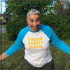 This is the front of the Strong Athletic Skater All-Gender White with Light Blue Sleeves Baseball T-Shirt with Yellow Ink. This shirt comes in sizes XS-2XL. This tank is soft and designed to fit casually. #strongathletic , #strongathleticskater , #strongathleticskaters , #rollerderby