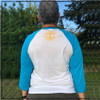 This is the back of the Strong Athletic Skater All-Gender White with Light Blue Sleeves Baseball T-Shirt with Yellow Ink. The Strong Athletic logo is printed in bright yellow ink on the center of the back. This shirt comes in sizes XS-2XL.  #strongathletic , #strongathleticskater , #strongathleticskaters , #rollerderby