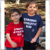 This is the Strong Athletic Kid Shirt by mommy owned company Strong Athletic. We made this shirt for all of the proud kids who love to play sports and athletics and tell the world that the are strong and athletic. This tee shirt has bright cherry red fabric with the words screen printed in white ink. We print this shirt design on Tultex tees. Strong Athletic is a woman-owned company, our goal is to support women, girls and members of the LGBTQIA2S+ Community in sports.