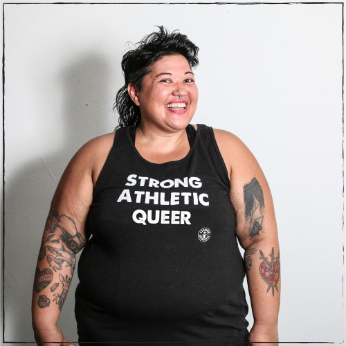 "We created this tank for the LGBT community, which Strong Athletic is a part of. This is the Strong Athletic Queer Fitted Tank. This tank is solid black with white ink. This tank is designed to be ""straight-cut"" meaning that it is not flowy. This tank is printed on a Bella Canvas product. This is our favorite tank and we donate a portion of profits to Pull for Pride."