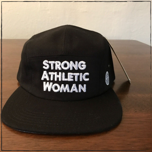 Strong Athletic created the Strong Athletic Woman 5-Panel Cap for all of the Strong Women in the world who want to make a statement. This black cap is embroidered with thick white letters in Austin, Texas. The black strap on the back is made from vegan leather.