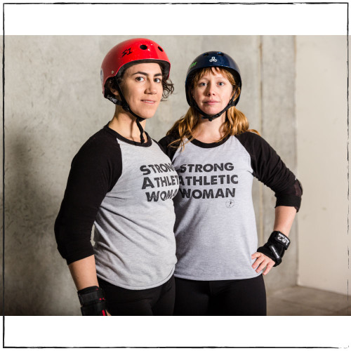 "This is the original Strong Athletic Woman Baseball T-shirt by Strong Athletic, first produced in 2014 for the Roller Derby World Cup in Dallas, Texas. Originally Strong Athletic was simply an idea and a phrase. Founder Nadia Kean would call teammates a ""fine group of strong, athletic, women"". Fellow teammate Cristen Perks was learning how to create art on adobe illustrator and screen print it on to shirts and hoodies. As a gift for Christmas in 2013 she put the three words on a gray shirt, stacked and in alignment in bold white ink. The shirt read, ""Strong Athletic Woman"". That Christmas gift changed Nadia's life, but at the time, it wasn't apparent how it would happen. In 2014 Nadia asked Cristen if she could print a run of the shirts for friends who wanted one. That year in June Cristen made about 60 shirts and Nadia sold them at Philly Roller Derby's very popular WFTDA sanctioned tournament ECDX. All of these shirts were unbranded, so just the three words on the front but no art otherwise. From then, they decided to brand the shirts, and used the name that Nadia coached under- Get Smarty Coaching. That's why these shirts say Get Smarty Coaching on them, rather than Strong Athletic. In 2015, Nadia and Cristen decided to separate Get Smarty Coaching from Strong Athletic and Nadia hired Angel Ortega to design the Strong Athletic logo. Since then all of our shirts have had the Strong Athletic logo on both the front and the back. So, if you ever see a Tultex grey t-shirt with Strong Athletic Woman printed o them, it's an original. If you see one with the Get Smarty Coaching logo on it, it's the second-generation  of our shirts, and if you see shirts with the Strong Athletic logo you know that it's part of the third generation of our shirts."