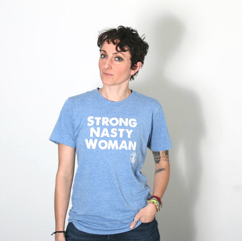 Front of the Strong Nasty Woman Crew Neck T-shirt. American Apparel Light-blue tri-blend track t-shirt with white ink. This shirt runs big, so read the sizing chart before ordering. Tell the world you're a Nasty woman. This shirt was hand printed and designed by women in Austin, Texas by Strong Athletic, a local business.