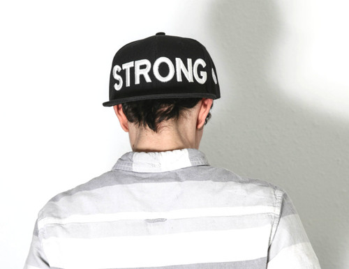 STRONG embroidered in 3-D bright white thread on an adjustable Yupoong snapback hat. Tell the world that your strong, while shading your eyes from the bright sun!