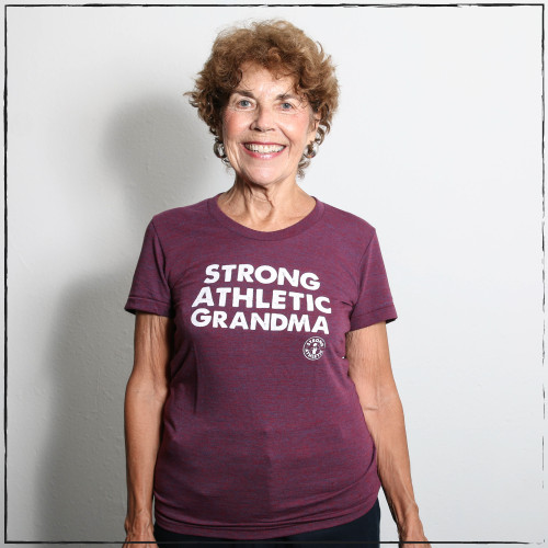 This is the new Strong Athletic Grandma t-shirt. This shirt is on a super stretchy and comfy American Apparel t-shirt. The tri-cranberry is a beautiful tone that will complement any grandmama. The cut is a women's traditional cut, so you can go with normal sizing. Tell your grandma she's the best and give her one of these shirts for Mother's Day! This shirt fits small, please double check the sizing chart.