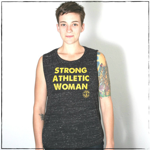 This is the front of the Strong Athletic Woman Flowy Muscle Tank with Black Marble and Yellow Ink. This tank breaths easy, so it makes it ideal for working out. The fabric is soft and stretchy. The words are as bold as the athletes who wear them across their chests.