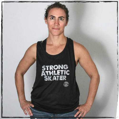 This is the front of the Strong Athletic Skater Super Muscle Tank. The words are printed in silver ink. This tank has dropped armholes, so that you can see more of the skin on the sides of the body. These SOLAS Jamaica Super Muscle Tanks are designed to fit super loose and flowy, so if you like your tanks a bit smaller, go down a size. This shirt comes in sizes XS-3XL.  Drop arm hole muscle tanks are perfect for going on a run. We love this design because the fabric is light weight and the holes for the arms are wide- making it so very little fabric is resting on our chests and our backs. Plus, we get to show off all of our funky running bras when we wear this tank because the design makes it so that much of our toros shows while we wear it. This shirt is made by Strong Athletic the company that supports women, girls and the LGBTQIA2S+ community in sports and athletic. Strong Athletic was founded by a roller derby skater. People love this tee because it's so soft and comfortable. Strong Athletic created the Strong Athletic Skater shirt because we wanted to amplify the voices of all the strong skaters in the world. Regardless of if you're a ramp skaters, a park skaters, a street skaters, a dance skater, a rink skater, a derby skaters, or an ice skater, we see you and support you.