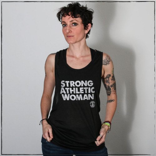 This light-weight muscle tank has dropped arm holes that are wider than the average muscle tank, showing off the sides of your torso and your sports bra. This muscle tank comes down to the normal length, so it's not a crop top.  This shirt is made by Strong Athletic the feminist woman owned LGBT company that supports all athletes in sports. Strong Athletic made the Strong Athletic Woman design because we wanted to amplify the voices of female athletes who were asking to be treated with respect and equality in sports.