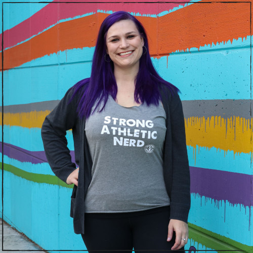 Need the perfect gift for the nerd in your life who is an athlete and who plays sports? Or is that nerd you and you want to have a shirt that reflect who you are? This is the perfect tee for nerds. It says three simple words on it: Strong, Athletic, Nerd, and makes it clear that you're in an athlete.