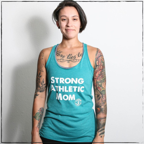 This is the Strong Athletic Mom Racerback Tank in Teal with White ink. This tank is a favorite because of the message that the shirt makes. This is a favorite gift for mom's on mother day. We print this design on Bella Canvas 8430. This is probably why this tank top is such a popular choice for people when they are buying Mother's Day gifts. #strongathletic , #strongathleticmom , #strongmom , #stongmoms , #momswholift , #stronglikemom , #mom , #momlife , #momblogger , #momstrong , momstrongfitness