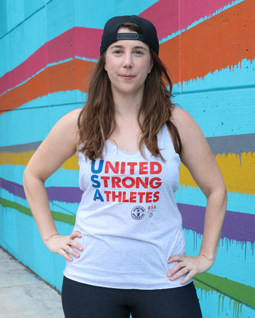 This is the front of the United Strong Athletes Racerback that Strong Athletic made in collaboration with USA Roller Derby in the lead up to the 2018 World Cup in Manchester, UK to help cover travel costs. In this image, retired USA player Aja Gair is modeling the racerback tank.