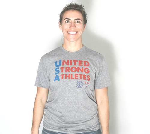 Front of the United Strong Athletes t-shirt. This is a gender neutral American Apparel t-shirt. The sleeves end right above the elbow. The shirt is athletic grey and the ink is red and blue. Use the tag #unitedstrongathletes when tagging us.
