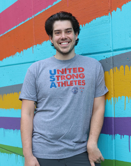 This is the front of the United Strong Athletes T-shirt, which is printed on a super comfortable grey t-shirt. The ink is a combination of blue and red, to represent the USA colors.