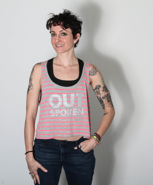 """This is the front of the OUTSpoken crop top designed by Strong Athletic. In certain light you can see the words jumping off of the tank, and in other light they blend right in. There are many ideas behind this crop, but two key ideas are this: one, the founder of Strong Athletic is part of the LGBT+ community and this tank is a nod to others who are out in that community. Two, not everyone is able to be out, so they must """"blend"""" in during their everyday life, so the words blending into this tank are part of that concept."""