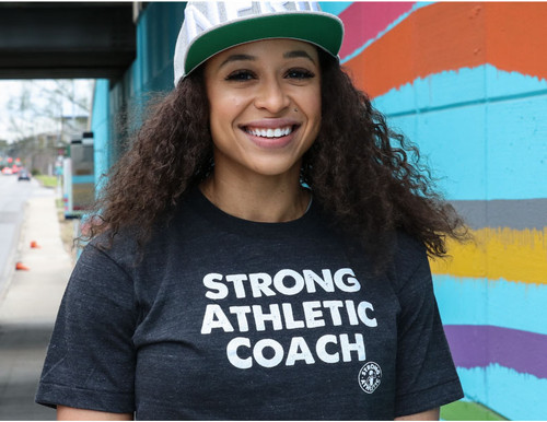 This is the Strong Athletic Coach Crew Neck T-shirt. Heather Black with white ink letters. This shirt is a great way to tell the world you're a proud coach.