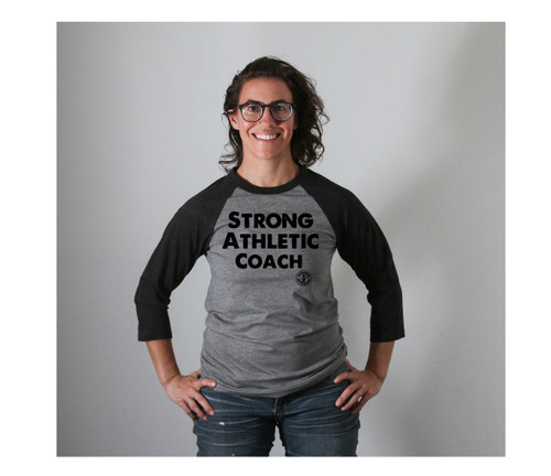 "Do you need a baseball t-shirt for fall? How about a grey baseball t-shirt with black sleeves? How about one with the words ""Strong Athletic Coach"" on it? Well, you know, we've got one. It's been the perfect shirt for coaches to wear to practice. It's also a great gift for your favorite coach."