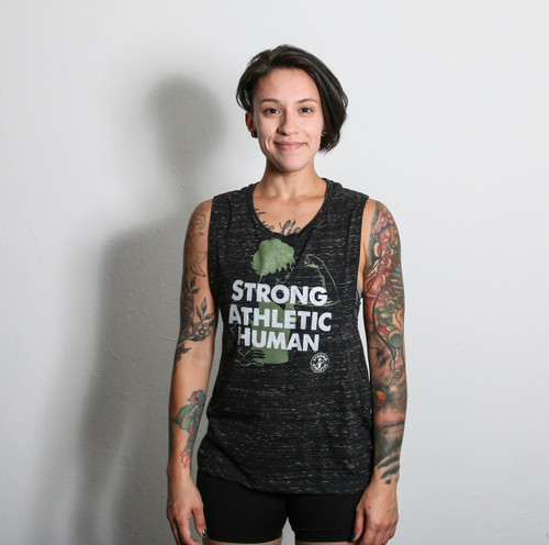 For the gym or just hanging out.  Flowy Muscle Tank. Strong Athletic Human.  See size chart provided to get the perfect fit. You are Strong. You will standout in this Strong Tank Top. We love this Bella Canvas tank because the drop arm sleeves make it so that it shows off our favorite bra. Strong Athletic is a queer and woman owned company that supports all humans in sports.