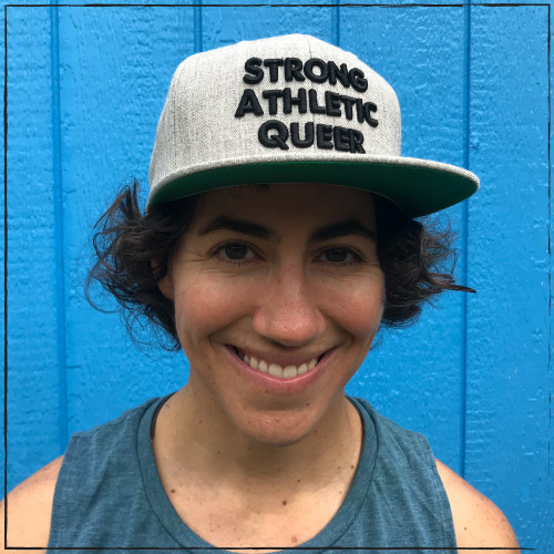 "We needed another snapback hat, so we created this one. This is the thick black embroidered Strong Athletic Queer Heather Grey snapback hat with Black Letters. If you wondered who makes this bad-ass Queer hat, wonder no more, now you know!   This Snapback Hat is made by Strong Athletic the queer-owned feminist woman owned LGBT company that supports all athletes in sports. Strong Athletic created the Strong Athletic Queer design because we know that LTBG athletes have not been given the freedoms or space that they need in sports. We want to help change that.    This Yupoong snapback hat is made at a Flexfit Facility, which is accredited by WARP Corp. These hats are crafted to last, and hat is why Yupoong hats are so popular. Strong Athletic guarantees that the stitching on your hat will not unravel and that the embroidery will last. If there is a production related issue with your hat- one that happened because the hat company made a mistake, get in touch and we'll let you know about how replacement policy. Need to wash your snapback hat? Follow the instructions in the ""about"" section.  $1 from each of these hats is donated to Pull for Pride!"