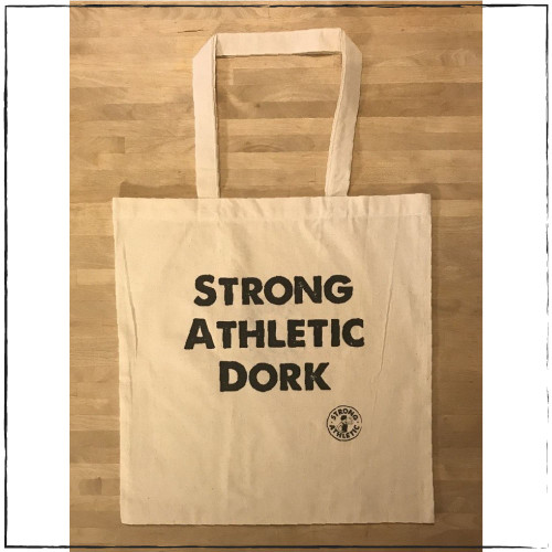 This is the front of the Strong Athletic Dork Tote Bag. Initially this design was created for members of the roller derby community. That's right. In 2017 skaters asked Strong Athletic to create a Strong Athletic Nerd shirt and once that was out and people saw it, we were quickly asked to make a Strong Athletic Dork shirt too. Soon after that we made some dork totes, cause dorks have stuff they need to carry around.  Now, some people think that nerds and dorks are the same thing, but they're wrong.