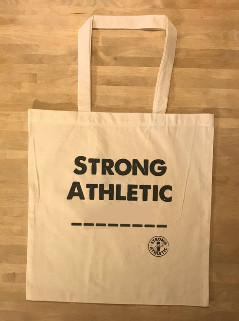 This is the Strong Athletic __________ Tote bag. The reason that we made this bag is because so many people in the Strong Athletic community are many things, and limiting themselves to one word is challenging and also unnecessary. With this tote you can fill in the blank line with a word that you identify with or you can leave it blank and be anything that you wan to be that day.