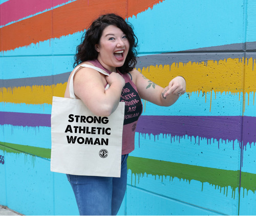 The Strong Athletic Woman Tote Bag is a favorite with women who are strong, athletic and they have stuff to do. This tote allows busy women to carry their things with them while also making a statement. Need a new tote bag? Want a cool Tote bag? Buy one from Strong Athletic! #strongathletic #strongathleticwoman #stongathleticwomen