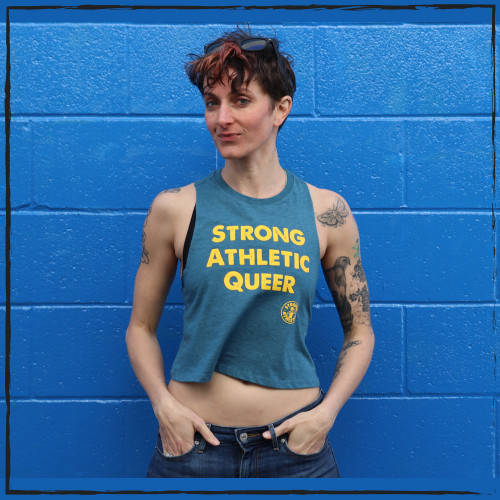 This is the front of the Strong Athletic Queer Deep Heather Teal with Yellow Ink Crop Racerback Tank Top by Strong Athletic. Strong Athletic is a proud LGBTQIA company. This is many people's favorite tanks to wear to LGBT Pride.  #strongathletic #strongathleticqueer , #queerathlete , #lgbtqia2s , #lgbt , #gayathlete , #queersinsport