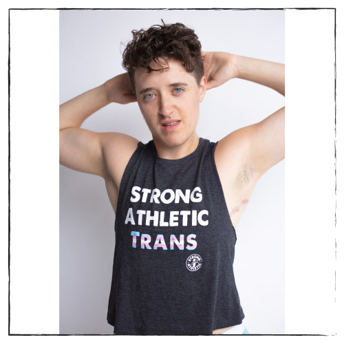 This is the front of the Strong Athletic Trans Crop Top Racerback by Strong Athletic. The tank is a casual fit with the sleeves designed to look as if you cut up your favorite shirt. The athlete in the photo is one of our favorites, Lex Horwitz. #strongathletic #strongathletictrans  Model: Mx. Lex Horwitz (@lex_horwitz) Photographer: Amanda Picotte (@amandapicotte) Studio: Holyrad Studio (@holyrad_studio) Underwear: TomboyX (@tomboyx)