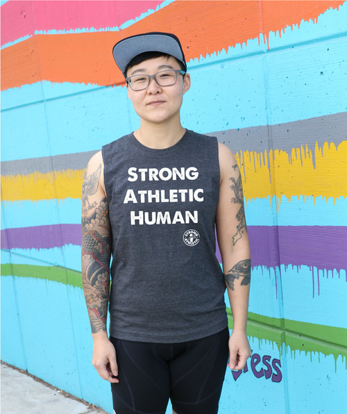 "This is the front of the Strong Athletic Human Muscle Tank designed by Strong Athletic for all of the amazing humans in the world who want to tell everyone that they are strong and athletic  This tank is printed on Bella Canvas Tank 3483. This tank is soft and stretchy, but goes right back into it's intended shape. This tank is designed to be more ""neutral"" and some call it ""all gender""."