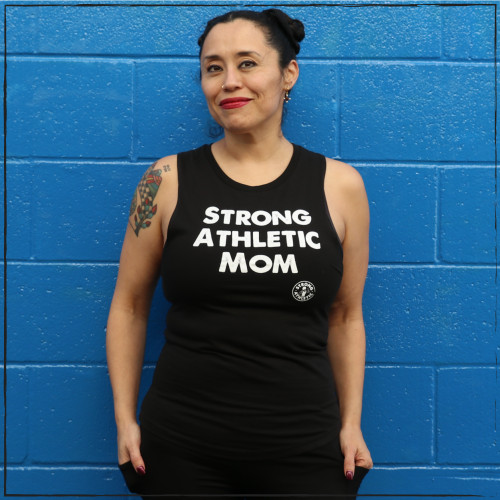 Strong Athletic is pro-mom and as part of our mission we want to make it clear that we think mothers and grandmothers and nonbinary parents all belong within sports and athletics. Looking for the perfect shirt to give to a mom that you love or for yourself? This is the front of the Strong Athletic Mom Fitted District Muscle Tank with dropped arm holes. This black muscle tank is the perfect cut and comes in sizes extra small to 4-extra large. Be sure to wear your favorite bra when you wear this tank 'cause a bit of your bra will probably show under the arms and on your back.