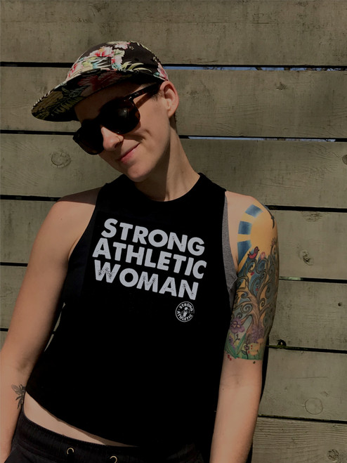 "This is the front of the Strong Athletic Woman Crop Top. Black fabric with white ink. This is a ""starter Crop"" in that it does come above the belt line, but it doesn't sit above the belly button, unless your torso is super long. We love this tank because it's light weight and soft, plus the ""cut"" is super."